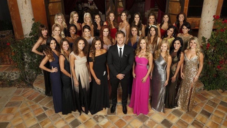 "Juan Pablo Galavis poses with the ladies on ""The Bachelor."""