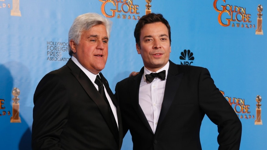January 13, 2014. Late night talk show hosts Jay Leno (L) and Jimmy Fallon pose backstage at the 70th annual Golden Globe Awards in Beverly Hills, California.