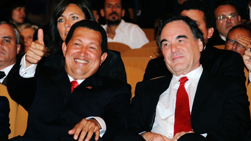 "VENICE, ITALY - SEPTEMBER 07:  Venezuela's President Hugo Chavez and director Oliver Stone attends the ""South Of The Border"" premiere at the Sala Grande during the 66th Venice Film Festival on September 7, 2009 in Venice, Italy.  (Photo by Francois Durand/Getty Images)"