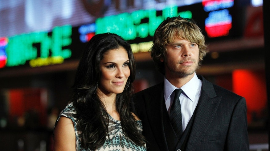 "Cast member Eric Christian Olsen poses with actress Daniela Ruah at the world premiere of ""The Thing"" at Universal Studios Hollywood in Universal City, California October 10, 2011."