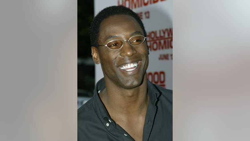 "Actor Isaiah Washington poses as he arrives for the premiere of his newfilm ""Hollywood Homicide"" in Los Angeles June 10, 2003. Washingtonportrays a music executive in the film starring Harrison Ford and JoshHartnett who play two detectives with hectic private lives who areinvestigating the murder of a rap group in the film which opens June13, 2003 in the United States. REUTERS/Fred ProuserFSP - RTRP5CN"