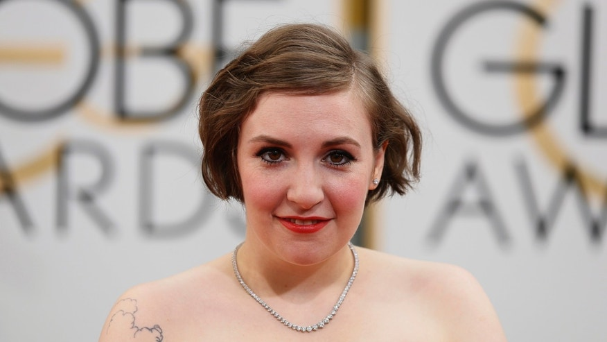 January 12, 2104. Lena Dunham arrives at the 71st annual Golden Globe Awards in Beverly Hills, California.
