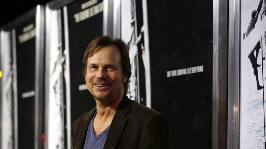 "Actor Bill Paxton poses at the premiere of ""Captain Phillips"" at the Academy of Motion Picture Arts and Sciences in Beverly Hills, California September 30, 2013."
