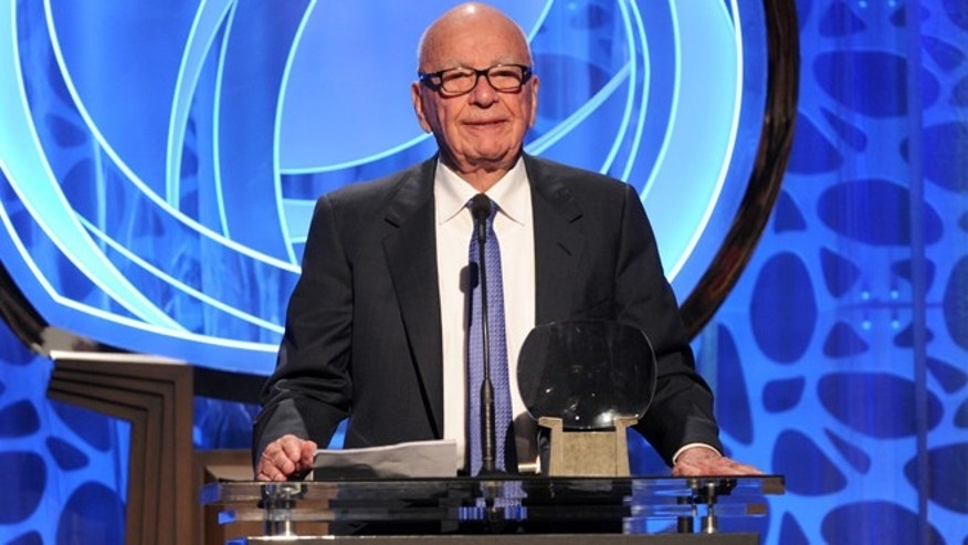 IMAGE DISTRIBUTED FOR THE TELEVISION ACADEMY - EXCLUSIVE - Hall of Fame inductee Rupert Murdoch speaks on stage at the 2014 Television Academy Hall of Fame on Tuesday, March 11, 2014, at the Beverly Wilshire in Beverly Hills, Calif. (Photo by Frank Micelotta/Invision for the Television Academy/AP Images)