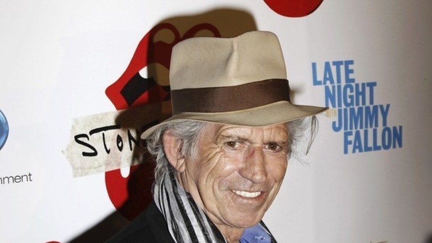 "Rolling Stones guitarist Keith Richards arrives for the premiere of the documentary film ""Stones In Exile"" in New York May 11, 2010. REUTERS/Lucas Jackson (UNITED STATES - Tags: ENTERTAINMENT HEADSHOT)"