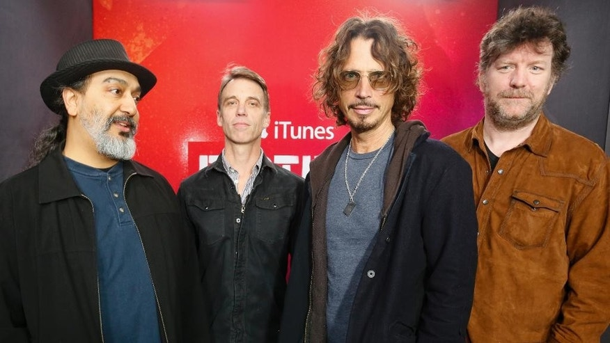 Soundgarden band members, from left, Kim Thayil, Matt Cameron, Chris Cornell and Ben Shepherd, pose for a photograph at the iTunes Festival showcase during the SXSW Music Festival on Thursday, March 13, 2014, in Austin, Texas. (Photo by Jack Plunkett/Invision/AP)