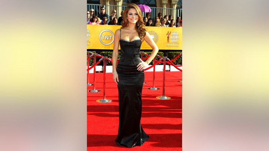 January 29, 2012. Maria Menounos poses on arrival at the 18th annual Screen Actors Guild Awards in Los Angeles, California.