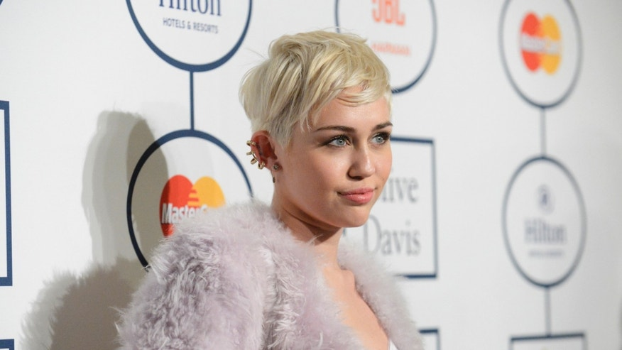January 25, 2014. Singer Miley Cyrus attends the Clive Davis Pre-Grammy Gala and Salute to Industry Icons, honoring Universal Music Group Chairman and CEO Lucian Grainge, in Beverly Hills, California.