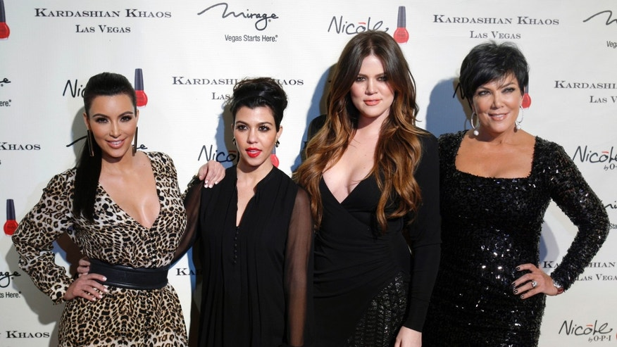 December 15, 2011. Television personalities (L-R) Kim Kardashian, Kourtney Kardashian, Khloe Kardashian and Kris Jenner arrive at the grand opening of the Kardashian Khaos store at the Mirage Hotel and Casino in Las Vegas, Nevada.