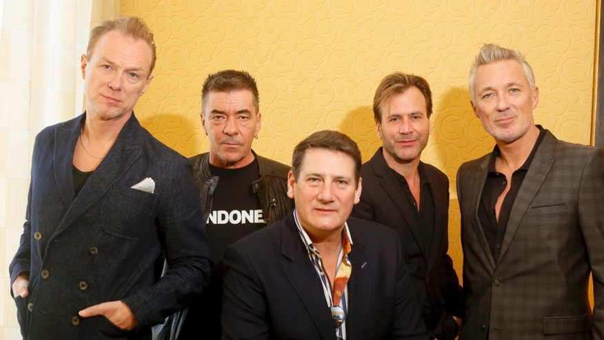 March 13, 2014. Spandau Ballet members, from left, Gary Kemp, John Keeble, Tony Hadley, Steve Norman and Martin Kemp pose for a photograph during the SXSW Music Festival.