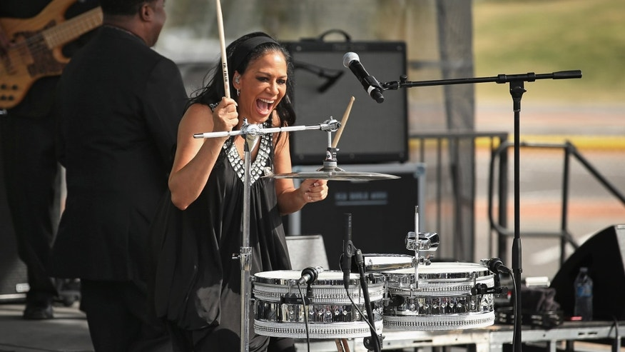 NORTH LAS VEGAS, NV - NOVEMBER 01:  Musican and actress Sheila Escovedo, known by her stage name Sheila E., performs during a campaign rally for U.S. President Barack Obama on the campus of the College of Southern Nevada November 1, 2012 in North Las Vegas, Nevada. With five days remaining in the presidential campaign, Obama travels today to Wisconsin, Colorado and Nevada after spending the last four days leading the federal government's response to Superstorm Sandy.  (Photo by Chip Somodevilla/Getty Images)