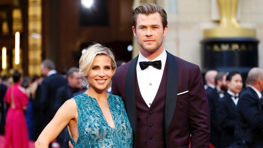 March 2, 2014. Actor Chris Hemsworth and his wife Elsa Pataky arrive at the 86th Academy Awards in Hollywood, California.