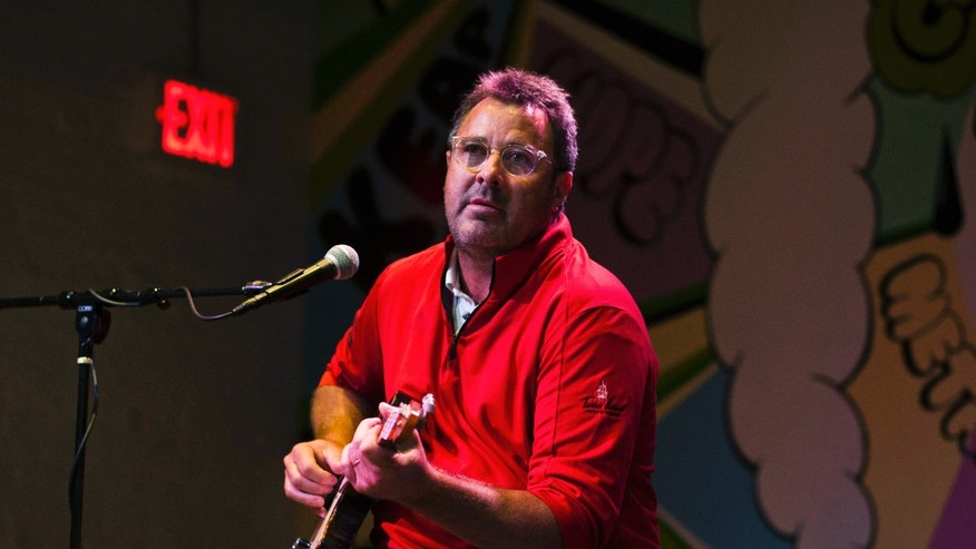 August 7, 2013. Singer-songwriter Vince Gill takes part in a Grammy camp for high school students in Brooklyn, New York.
