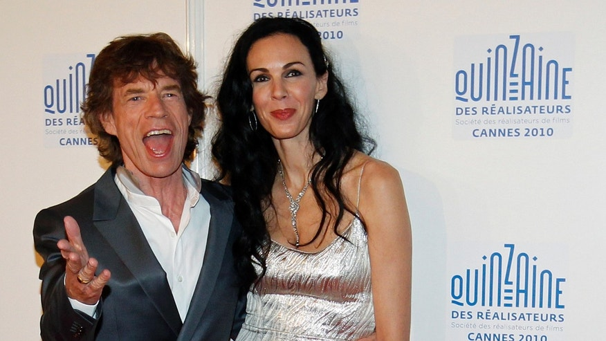 "May 19, 2010. Rolling Stones lead singer Mick Jagger and fashion stylist L'Wren Scott arrive at the ""Quinzaine des Realisateurs"" at the 63rd Cannes Film Festival."