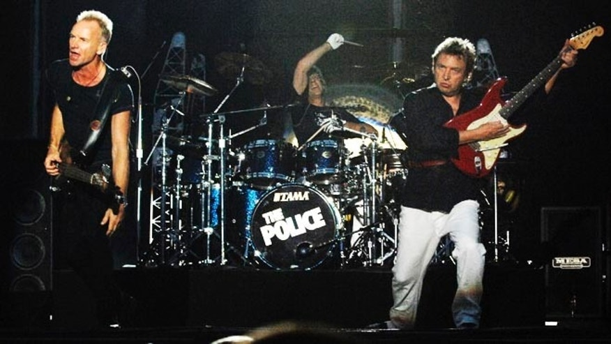 The Police performs at Virgin Festival, at Pimlico Race Course, in Baltimore, Maryland, August 4, 2007. (L-R) Sting, Stewart Copeland and Andy Summers. The two-day concert is now in its second year. REUTERS/Bill Auth  (UNITED STATES) - RTR1SIQX