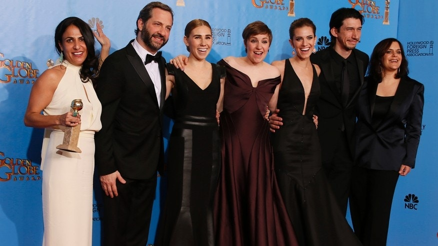 "The cast and crew of ""Girls,"" (From L:) producer Jennifer Konne, producer Judd Apatow, cast members Zosia Mamet. Lena Dunham, Allison Williams and Adam Driver and director Ilene S. Landress, pose backstage after they won for Best Televison Series, Comedy or Musical at the 70th annual Golden Globe Awards in Beverly Hills, California, January 13, 2013.  REUTERS/Lucy Nicholson (UNITED STATES  - Tags: ENTERTAINMENT)  (GOLDENGLOBES-BACKSTAGE) - RTR3CFCB"