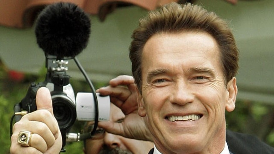 California Gov. Arnold Schwarzenegger gives a thumbs-up after voting at a polling place at a home in Los Angeles' Brentwood district Tuesday, Nov. 8, 2005.  (AP Photo/Reed Saxon)