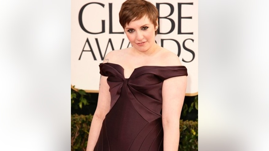 "Actress Lena Dunham of the TV series ""Girls"" at the 70th annual Golden Globe Awards in Beverly Hills, California January 13, 2013. REUTERS/Jason Redmond (UNITED STATES - Tags: Entertainment) (GOLDENGLOBES-ARRIVALS) - RTR3CEVZ"