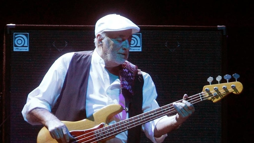 FILE - This April 8, 2013 file photo shows bassist John McVie performing during a Fleetwood Mac concert at Madison Square Garden in New York.  The band announced a 33-city U.S. tour Thursday, March 27, 2014, and it's the first set of shows since they cancelled performances last year as bassist John McVie was treated for cancer. (Photo by Jason DeCrow/Invision/AP, file)
