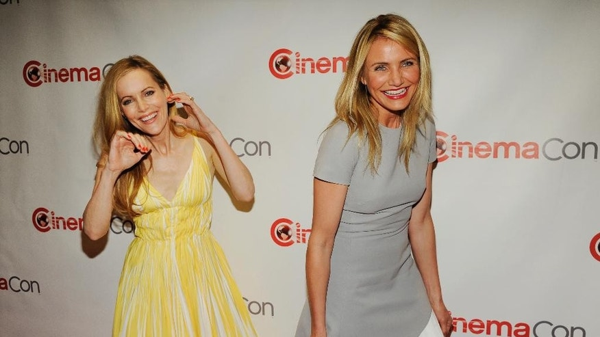 "Leslie Mann, left, and Cameron Diaz, cast members in ""The Other Woman,"" arrive for the 20th Century Fox presentation at CinemaCon 2014 on Thursday, March 27, 2014, in Las Vegas. (Photo by Chris Pizzello/Invision/AP)"
