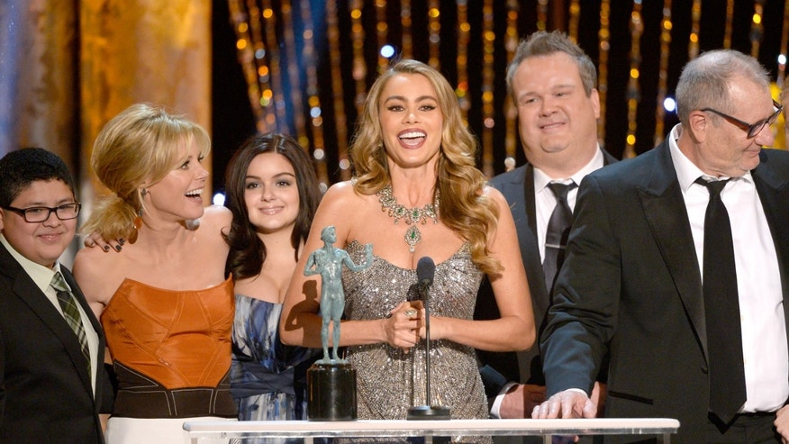 LOS ANGELES, CA - JANUARY 18:  (L-R) Actors Rico Rodriguez, Julie Bowen, Ariel Winter, Sofia Vergara, Eric Stonestreet, and Ed O'Neill accept the Outstanding Performance by an Ensemble in a Comedy Series award for 'Modern Family' onstage during the 20th Annual Screen Actors Guild Awards at The Shrine Auditorium on January 18, 2014 in Los Angeles, California.  (Photo by Kevork Djansezian/Getty Images)