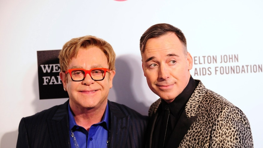 March 2, 2014. Elton John (L) and David Furnish arrive at the 2014 Elton John AIDS Foundation Oscar Party in West Hollywood, California.