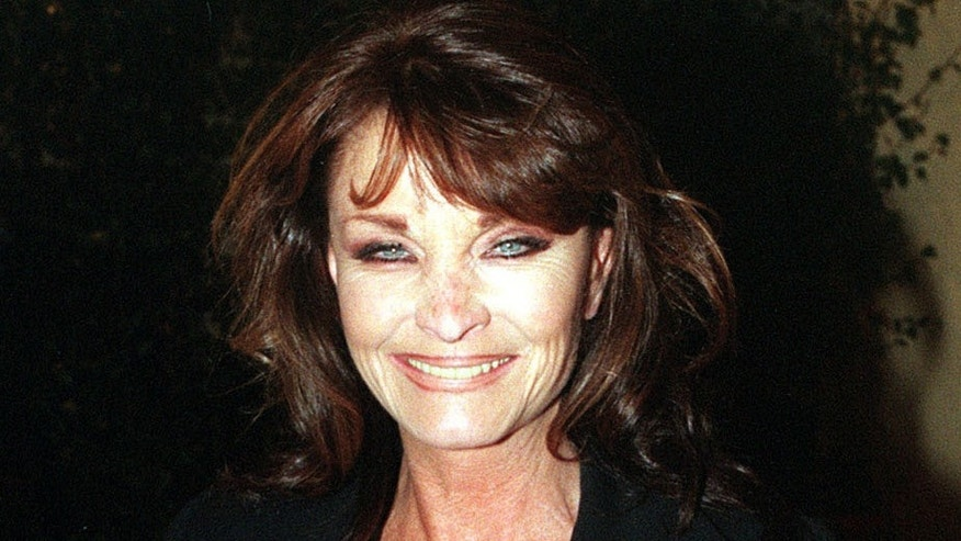 "Oct. 6 1998. British actress Kate O'Mara poses for photographers.  Actress Kate O'Mara, best known for her role in the 1980s soap opera ""Dynasty,"" has died at the age of 74."