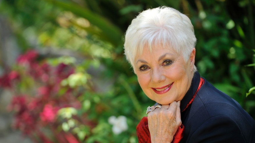 July 15, 2013. Actress Shirley Jones poses for a portrait at her home in Los Angeles.  Jones wants to mark her 80th birthday with a high-flying adventure. The Oscar-winning actress and singer says she plans to go skydiving on Monday, March 31, 2014, her birthday, for the first time.
