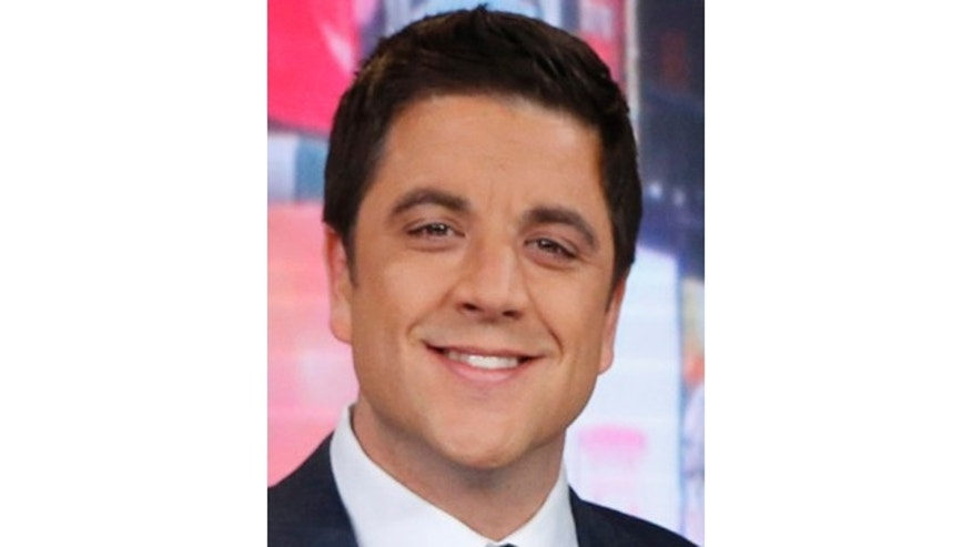 February 20, 2013: This file photo released by ABC shows Josh Elliott, on the set of 'Good Morning America' in New York.  ABC's top-rated morning show has suffered its second personnel defection in four months, with news anchor Elliott telling the network that he's leaving for a job at NBC Sports. (AP Photo/ABC, Heidi Gutman, File)