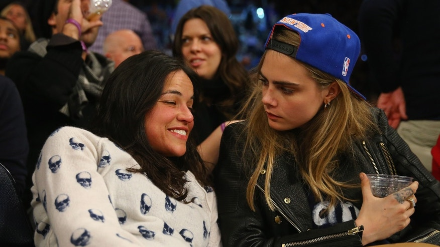 NEW YORK, NY - JANUARY 07:  Actress Michelle Rodriguez sits with with model Cara Delevingne during the game between the New York Knicks and the Detroit Pistons at  Madison Square Garden on January 7, 2014 in New York City.  NOTE TO USER: User expressly acknowledges and agrees that, by downloading and/or using this photograph, user is consenting to the terms and conditions of the Getty Images License Agreement. (Photo by Al Bello/Getty Images)