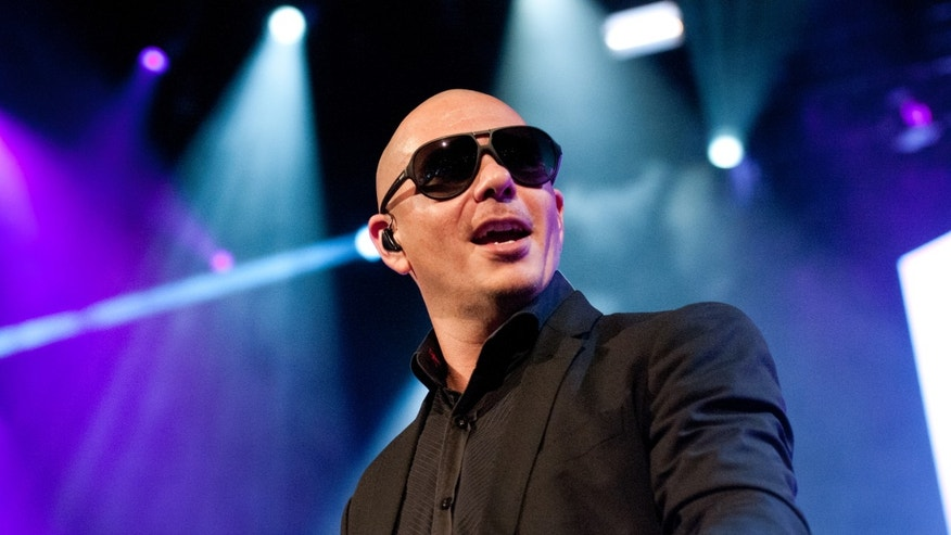 Pitbull performs at the Barclays Center on December 26, 2013 in New York City.
