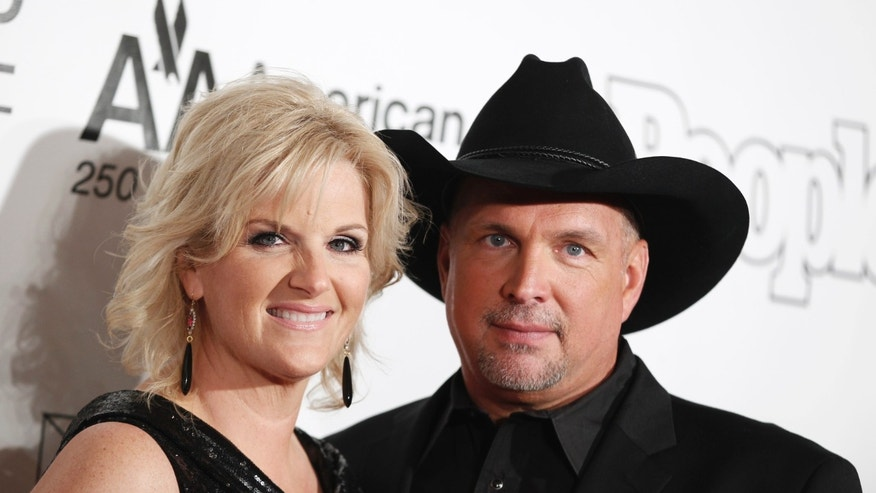 June 16, 2011. Singers Garth Brooks and Trisha Yearwood pose as they arrive for the Songwriters Hall of Fame awards in New York.