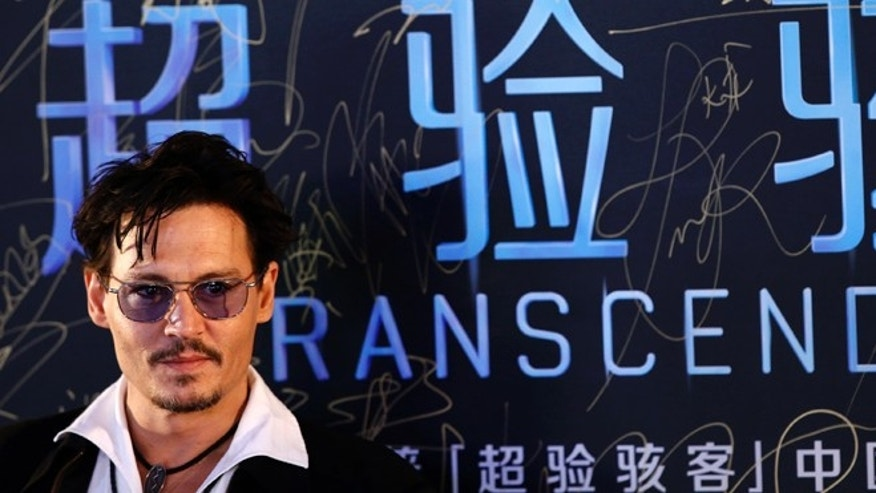 "Actor Johnny Depp attends a red carpet event to promote his new movie ""Transcendence"", on his first visit to China in Beijing March 31, 2014.REUTERS/Kim Kyung-Hoon (CHINA - Tags: ENTERTAINMENT) - RTR3JBV1"