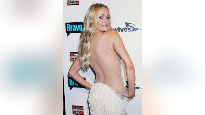 "October 11, 2010. Cast member Taylor Armstrong of Bravo's reality series ""The Real Housewives of Beverly Hills"" poses at the premiere party in Los Angeles."