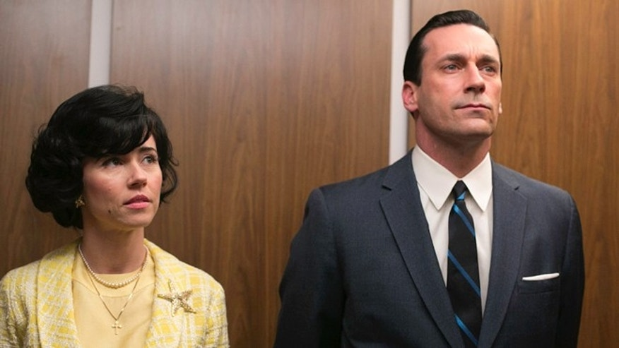 "This TV publicity image released by AMC shows Linda Cardellini as Sylvia Rosen, left, and Jon Hamm as Don Draper in a scene from ""Mad Men."""