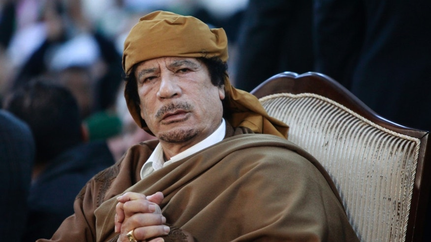 February 13, 2011. Libyan leader Muammar Gaddafi attends a ceremony marking the birth of Islam's Prophet Mohammed in Tripoli.