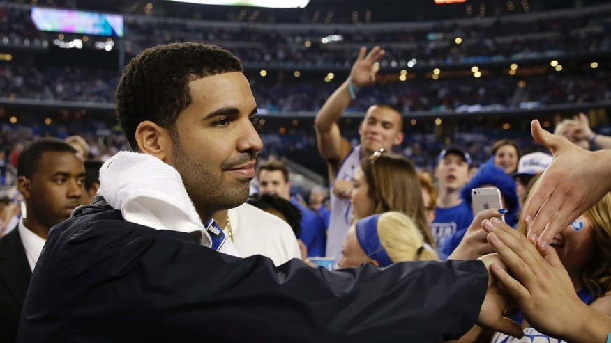April 5, 2014. Canadian entertainer Drake greets Kentucky fans during halftime of an NCAA Final Four tournament college basketball semifinal game against Wisconsin in Arlington, Texas.