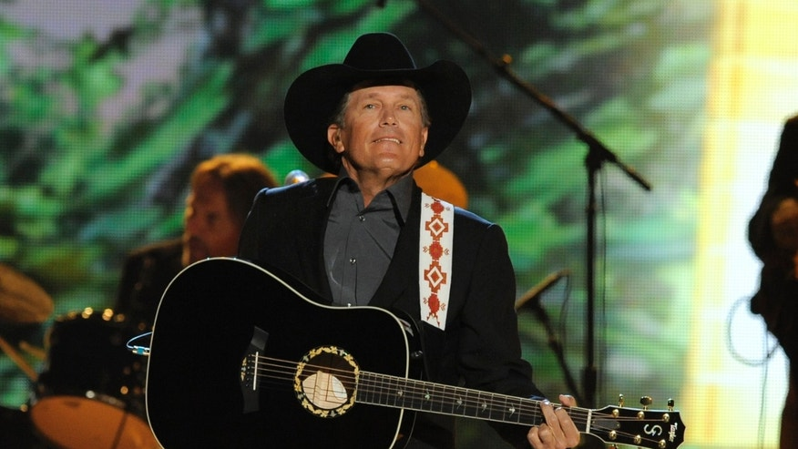 April 7, 2013 Singer George Strait performs at the 48th Annual Academy of Country Music Awards at the MGM Grand Garden Arena in Las Vegas.