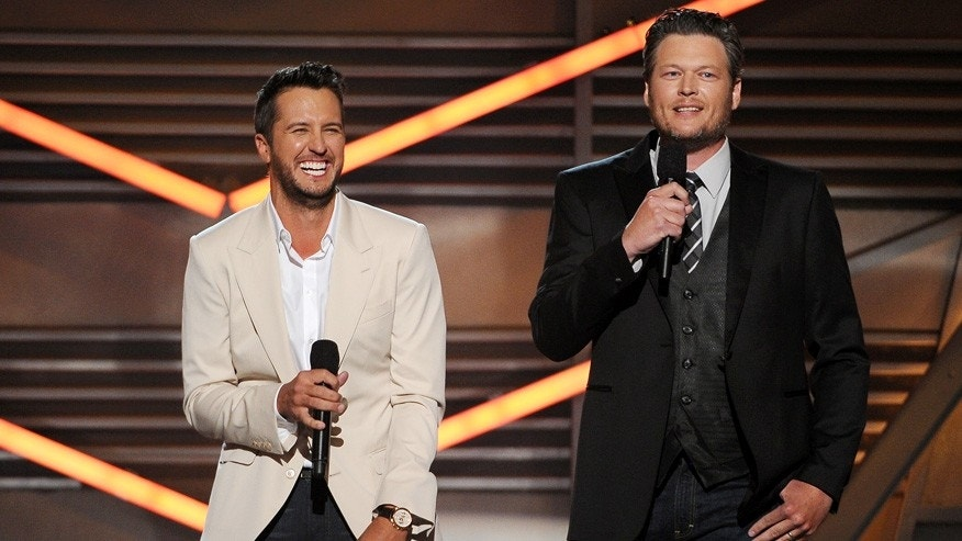 Hosts Luke Bryan, left, and Blake Shelton speak on stage at the 49th annual Academy of Country Music Awards at the MGM Grand Garden Arena on Sunday, April 6, 2014, in Las Vegas. (Photo by Chris Pizzello/Invision/AP)