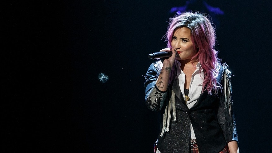 VANCOUVER, BC - FEBRUARY 09:  Demi Lovato performs 'The Neon Lights Tour' opener at Rogers Arena on February 9, 2014 in Vancouver, Canada.  (Photo by Andrew Chin/Getty Images)