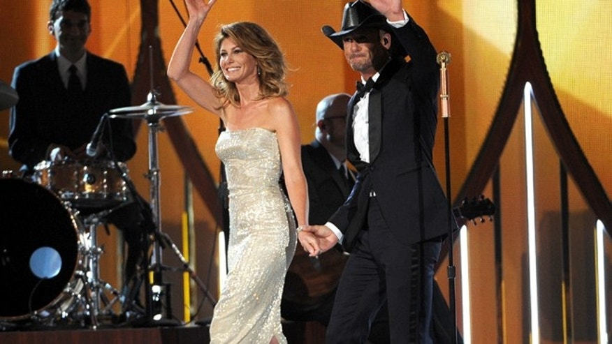 Apr. 6, 2014: Faith Hill, left, and Tim McGraw walk on stage at the 49th annual Academy of Country Music Awards at the MGM Grand Garden Arena in Las Vegas.
