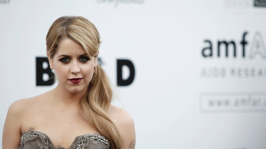 In this Thursday, May 21, 2009, file photo, British socialite Peaches Geldof arrives for the amfAR Cinema Against AIDS benefit at the Hotel du Cap-Eden-Roc, during the 62nd Cannes International film festival, in Antibes, southern France.