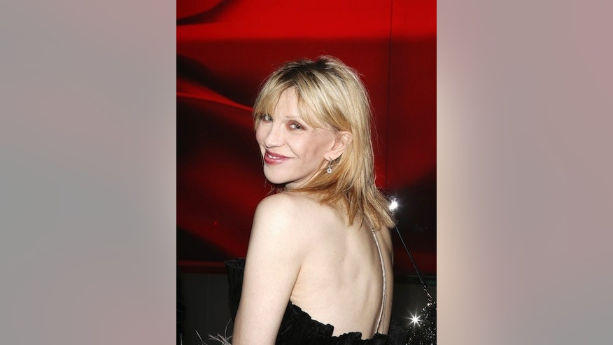 Singer Courtney Love arrives at a party to celebrate the opening of a virtual museum dedicated to Italian fashion designer Valentino, in New York, December 7, 2011. REUTERS/Carlo Allegri (UNITED STATES - Tags: ENTERTAINMENT) - RTR2UZGF