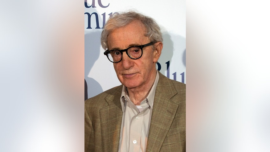 "August 27, 2013.  Woody Allen poses during the premiere of his film ""Blue Jasmine"" in Paris."