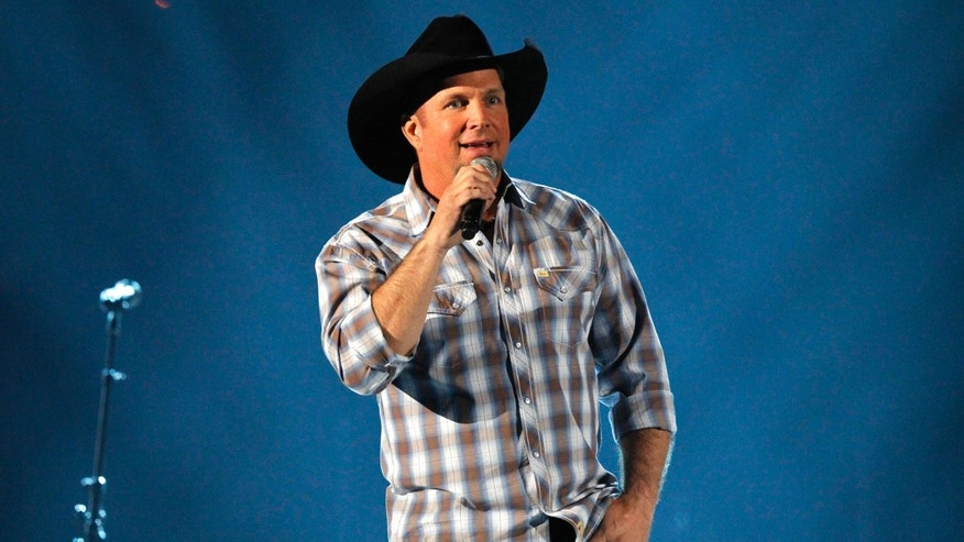 "April 7, 2013. Garth Brooks sings ""The Dance"" as a tribute to Dick Clark at the 48th ACM Awards in Las Vegas."