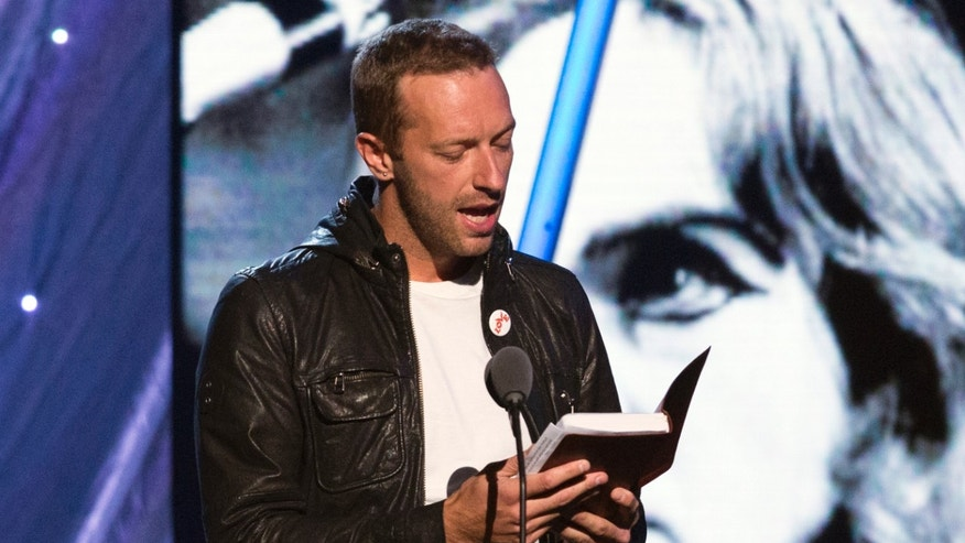 April 10, 2014. Coldplay lead vocalist Chris Martin reads from a Bible before inducting British musician Peter Gabriel during the 29th annual Rock and Roll Hall of Fame Induction Ceremony at the Barclays Center in Brooklyn, New York.