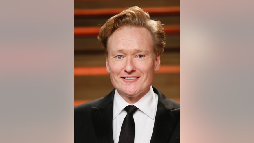 March 2, 2014. Conan O'Brien arrives at the 2014 Vanity Fair Oscars Party in West Hollywood, California.