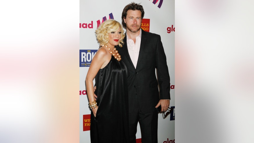 April 10, 2011. Tori Spelling and husband Dean McDermott arrive at the 22nd annual Gay and Lesbian Alliance Against Defamation (GLAAD) Media Awards in Los Angeles, California.