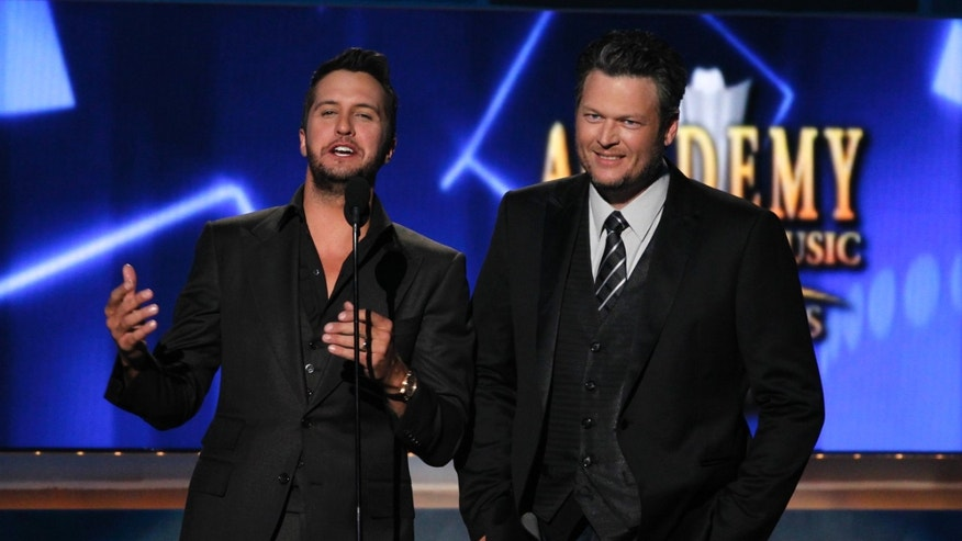 April 6, 2014. Show hosts Luke Bryan (L) and Blake Shelton speak on stage at the 49th Annual Academy of County Music Awards in Las Vegas, Nevada.
