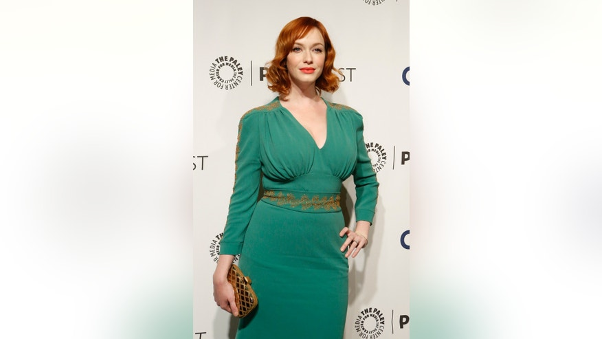 "March 21, 2014. Cast member Christina Hendricks poses as she arrives for a panel discussion for the television series ""Mad Men"" during the The William S. Paley Television Festival at the Dolby theatre in Hollywood, California."